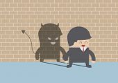Devil Shadow Behind Smiling Businessman