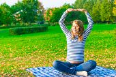 Pregnant Woman Doing Fitness Outdoor In A Park