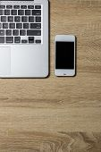Open Notebook And Smartphone On Wooden Background, Top View