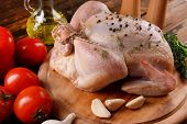picture of chicken  - Raw chicken on wooden table - JPG