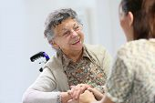 Elderly woman sharing good time with home carer