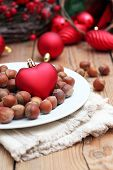 Christmas Hearth With Nuts On A White Plate