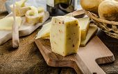 image of cheese-steak  - Delicious ripe cheese with crispy baguette and wine wood board - JPG