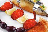 red salmon caviar with smoked fish and toast