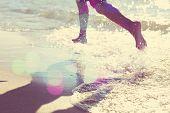 stock photo of children beach  - Child running at the beach - JPG