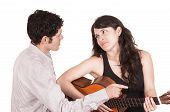 Beautiful frustrated female guitar student and teacher