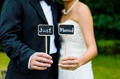 Couple holding Just Married sign