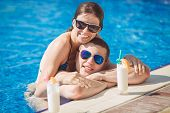 Attractive young couple swimming in the pool.