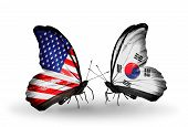 stock photo of south american flag  - Two butterflies with flags on wings as symbol of relations USA and South Korea - JPG