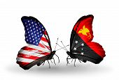 Two Butterflies With Flags On Wings As Symbol Of Relations Usa And Papua New Guinea