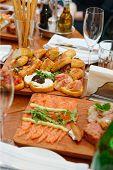 Restaurant table full of Italian starters