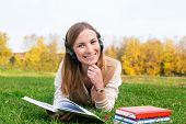 Student Listening Headphones And Reading Book