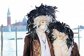 Couple Of Masks With Feathers At The Carnival Of Venice