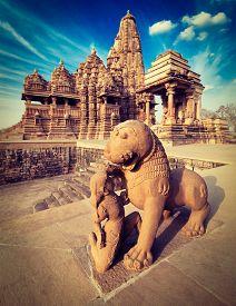 picture of kandariya mahadeva temple  - King and lion fight statue and Kandariya Mahadev temple - JPG