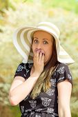 picture of crazy hat  - Portrait of grimace cheerful fashionable woman in stylish hat and frock - JPG