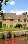stock photo of slaughter  - Cotswold cottages alongside the river Eye Lower Slaughter Cotswolds Gloucestershire England UK Western Europe - JPG