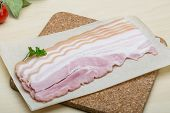 image of bacon strips  - Raw Bacon strips on the wood background - JPG