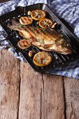 foto of fried onion  - fried carp with lemon onion and spices on the grill pan horizontal - JPG