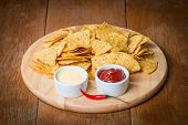 foto of nachos  - nachos with various sauces on wooden table - JPG