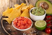 foto of nachos  - Green Guacamole with nachos and avocado on stone background - JPG
