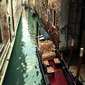 picture of gondola  - Beautiful city view and typical gondola at narrow venetian canal - JPG