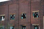 picture of illinois  - Broken windows on the walls of the old Joliet Steel Works in Joliet - JPG