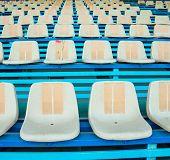 stock photo of bleachers  - Sport stadium plastic chair on bleachers view row - JPG