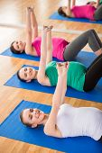 image of pregnancy exercises  - Group of young pregnant women are doing relaxation exercise on exercise mat