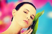 picture of bamboo leaves  - Beautiful woman with artistic make up and bamboo leaves - JPG