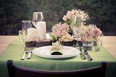 stock photo of wedding table decor  - Retro stylized photo of wedding table setting in rustic style - JPG