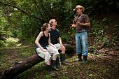 stock photo of vaquero  - Couple with nature guide in Costa Rican cloud forest - JPG