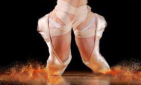 stock photo of  dancer  - dancer in ballet shoes dancing in Pointe on a wooden floor - JPG