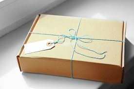 stock photo of packages  - Mail package parcel on white background - JPG