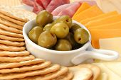 picture of pimiento  - A snack plate with pimiento stuffed green olives and crackers - JPG