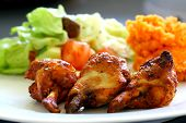 picture of roast chicken  - grilled chicken on a white plate with vegetables on the background - JPG