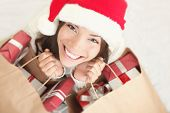 stock photo of christmas hat  - Woman shopping for christmas gifts - JPG