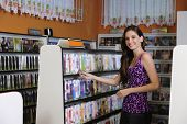 Teenage Girl At The Video Rental Store