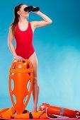 ������, ������: Lifeguard On Duty Looking Through Binocular