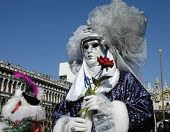 stock photo of clown rose  - a woman with a rose is dressed for carnivale in veniceitaly - JPG