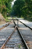 image of divergent  - Separate train tracks either merging or diverging and going off into the unknown - JPG