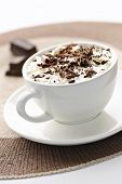 foto of hot-chocolate  - Cup of hot cocoa with shaved chocolate and whipped cream - JPG