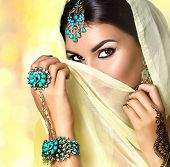 Постер, плакат: Brunette Indian woman portrait Indian girl in sari with mehndi tatoo and make up hiding her face be