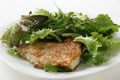 stock photo of flounder  - fried flounder with salad on a plate - JPG