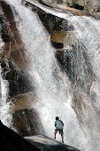 Hiker next to waterfall