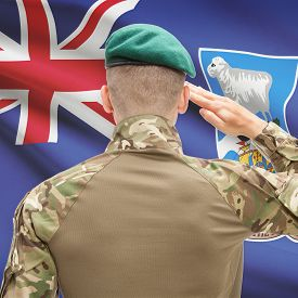 picture of falklands  - Soldier in hat facing national flag series  - JPG