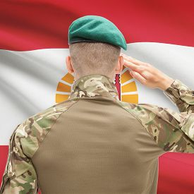 stock photo of french polynesia  - Soldier in hat facing national flag series  - JPG