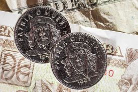 pic of pesos  - Cuban Peso bank notes and coins in a close up picture  - JPG