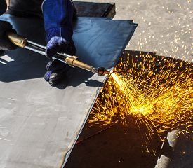 pic of ppe  - Workers in factories cut steel with gas fire heater - JPG