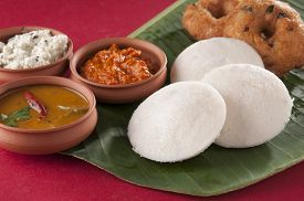stock photo of urad  - food South Indian food idli vada with sambar on a banana leaf - JPG