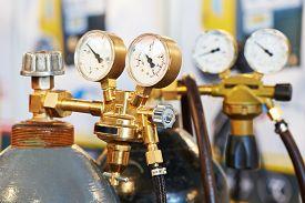 stock photo of manometer  - welding equipment acetylene gas cylinder tank with gauge regulators manometers - JPG